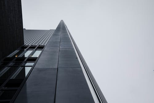 Low Angle Photography of Gray Concrete Building