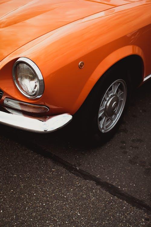 Orange Car on Black Asphalt Road