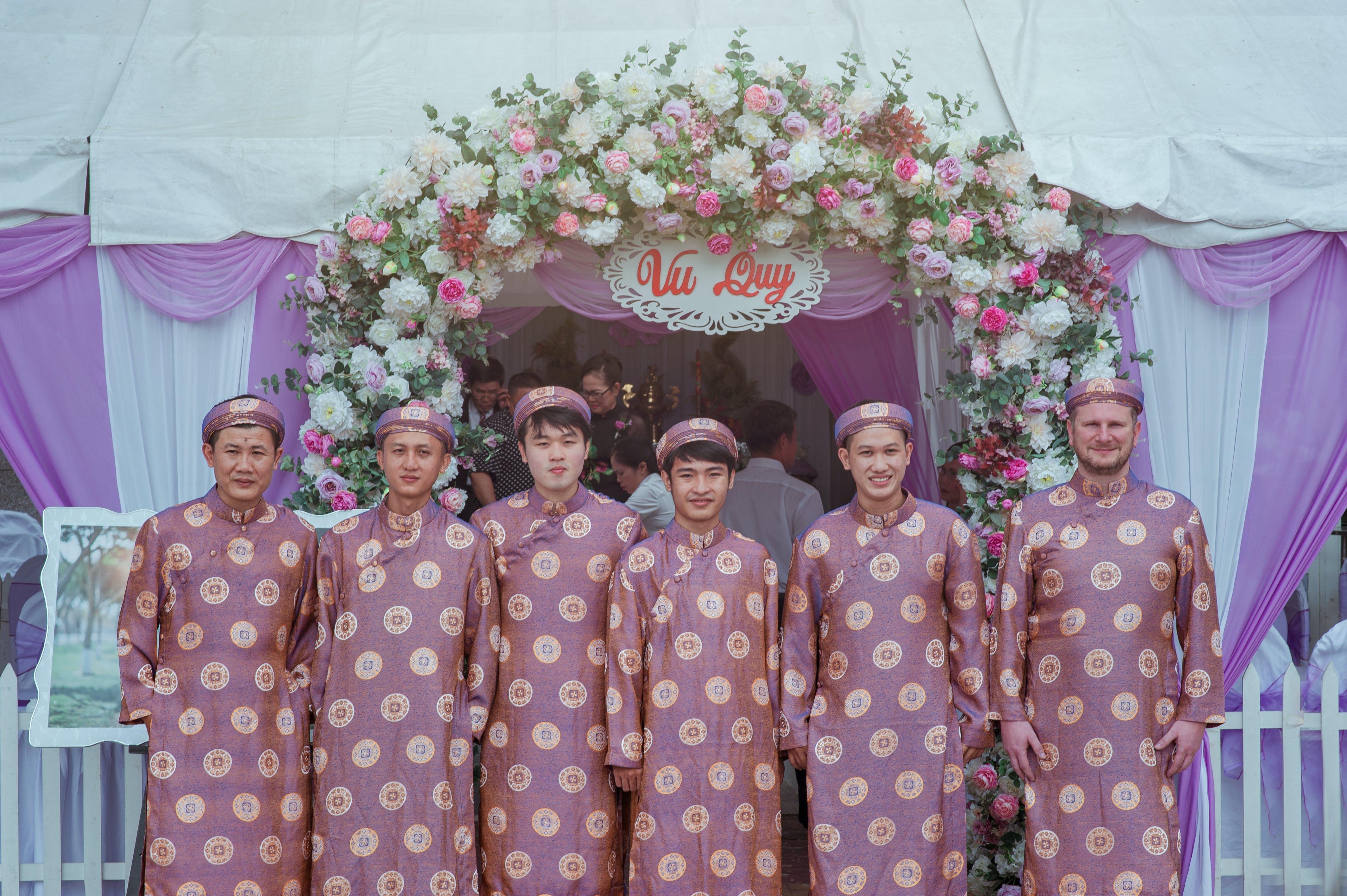 Group of Men Wearing Pink Robes