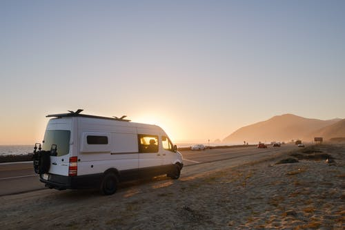 White Van on Gray Sand