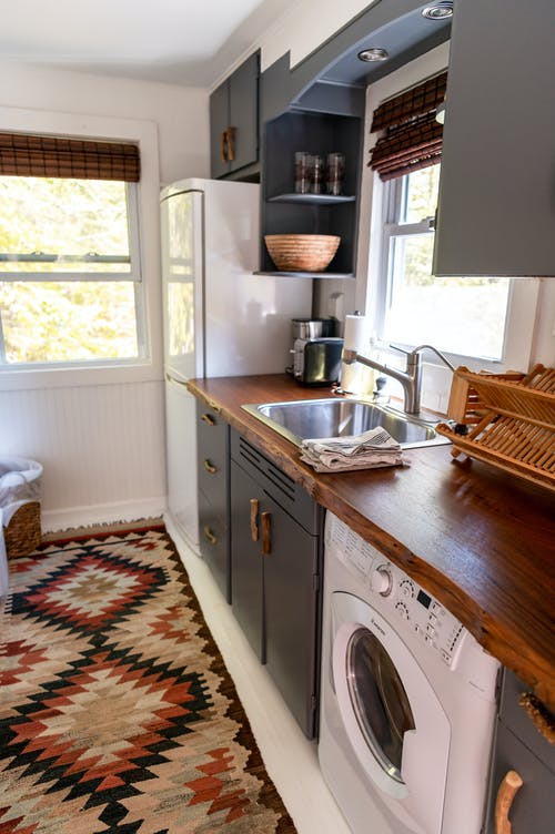White Front Load Washing Machine Beside White Wooden Framed Glass Window