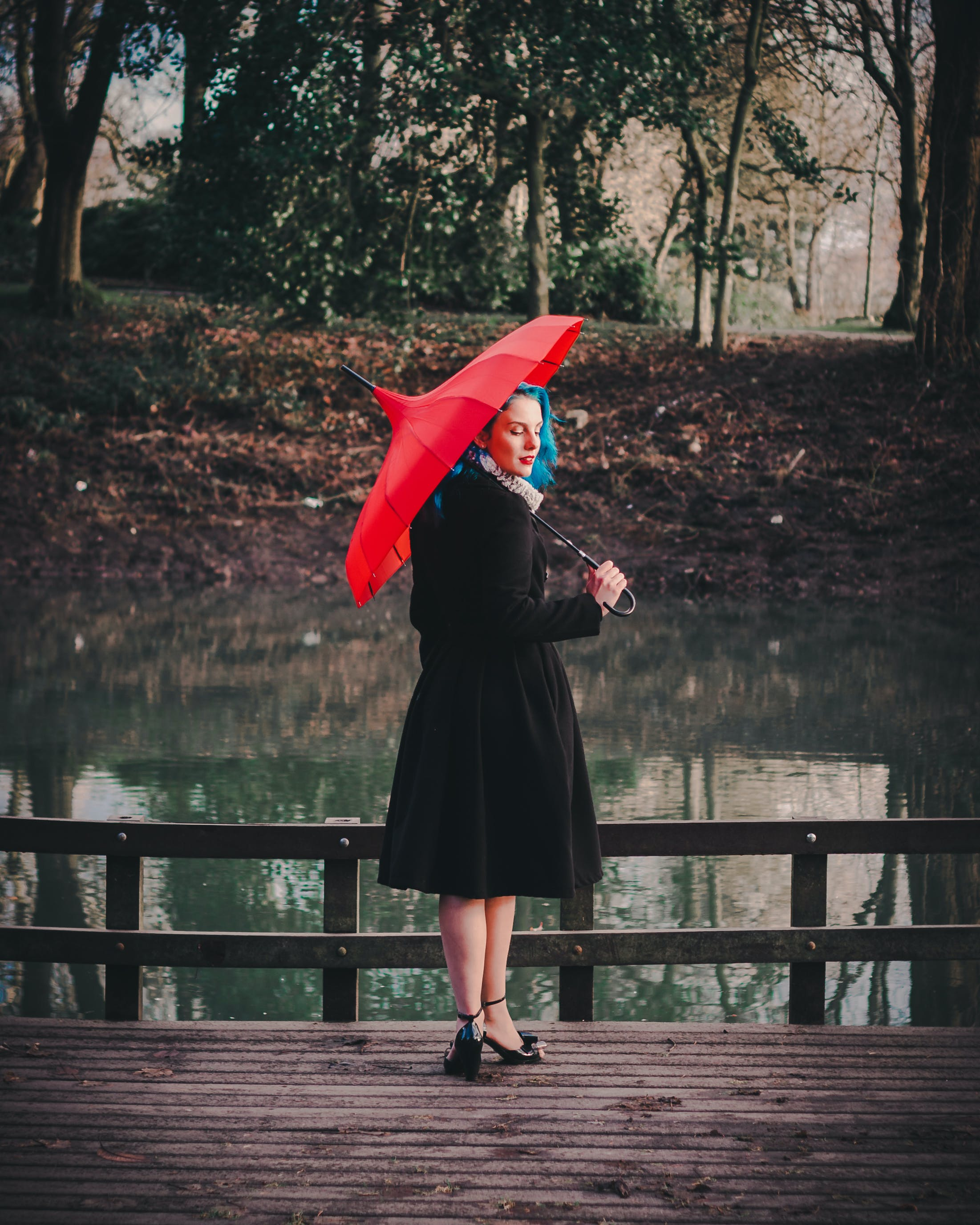 Woman Wearing Black Long-sleeved Dress Holding Red Umbrella