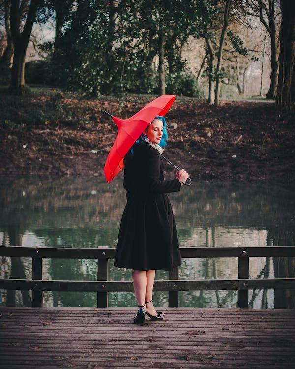 Woman Wearing Black Long-sleeved Dress Holding Red Umbrella