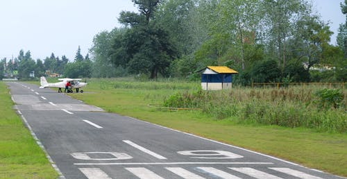 Free stock photo of airplane, airplane wing, asphalt