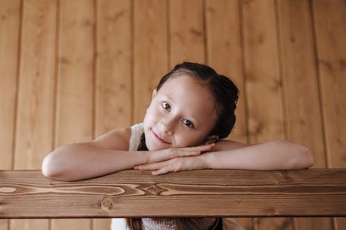 Girl Leaning on Railing