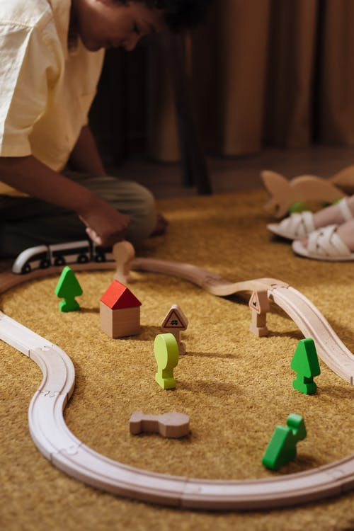 Children Playing With Train Toy