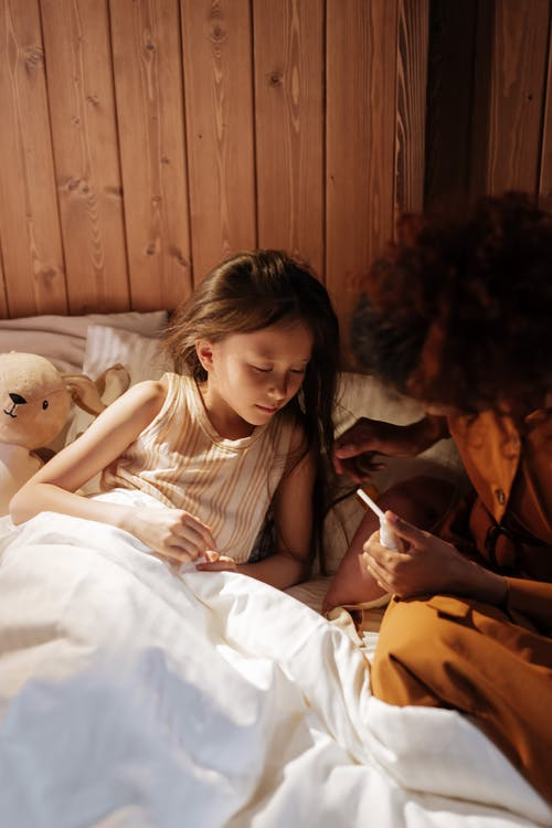 Mother Taking Care of Sick Daughter