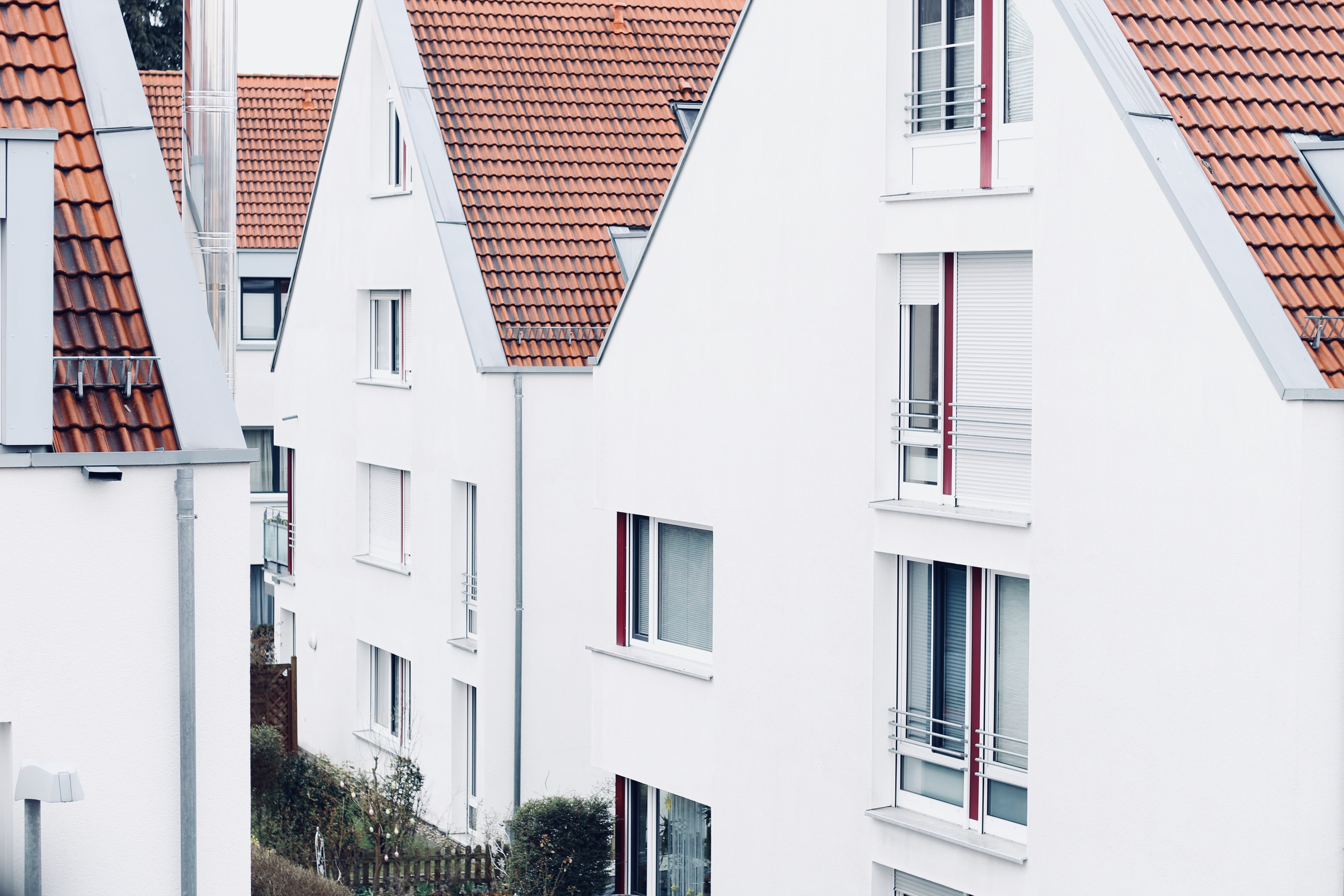 Photo of White Concrete Houses at Daytime