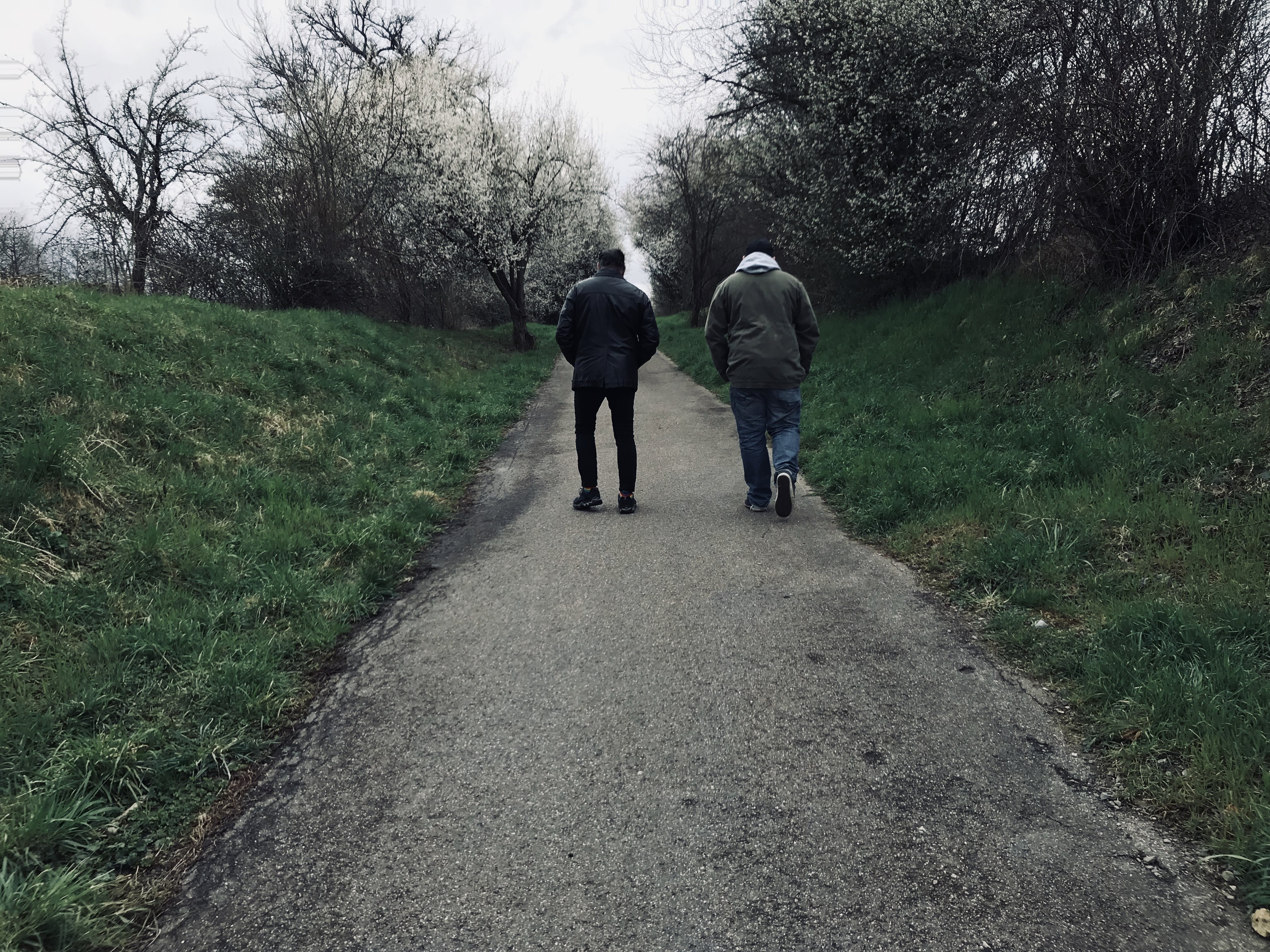 Two Person in Grey Jacket and Blue Jeans