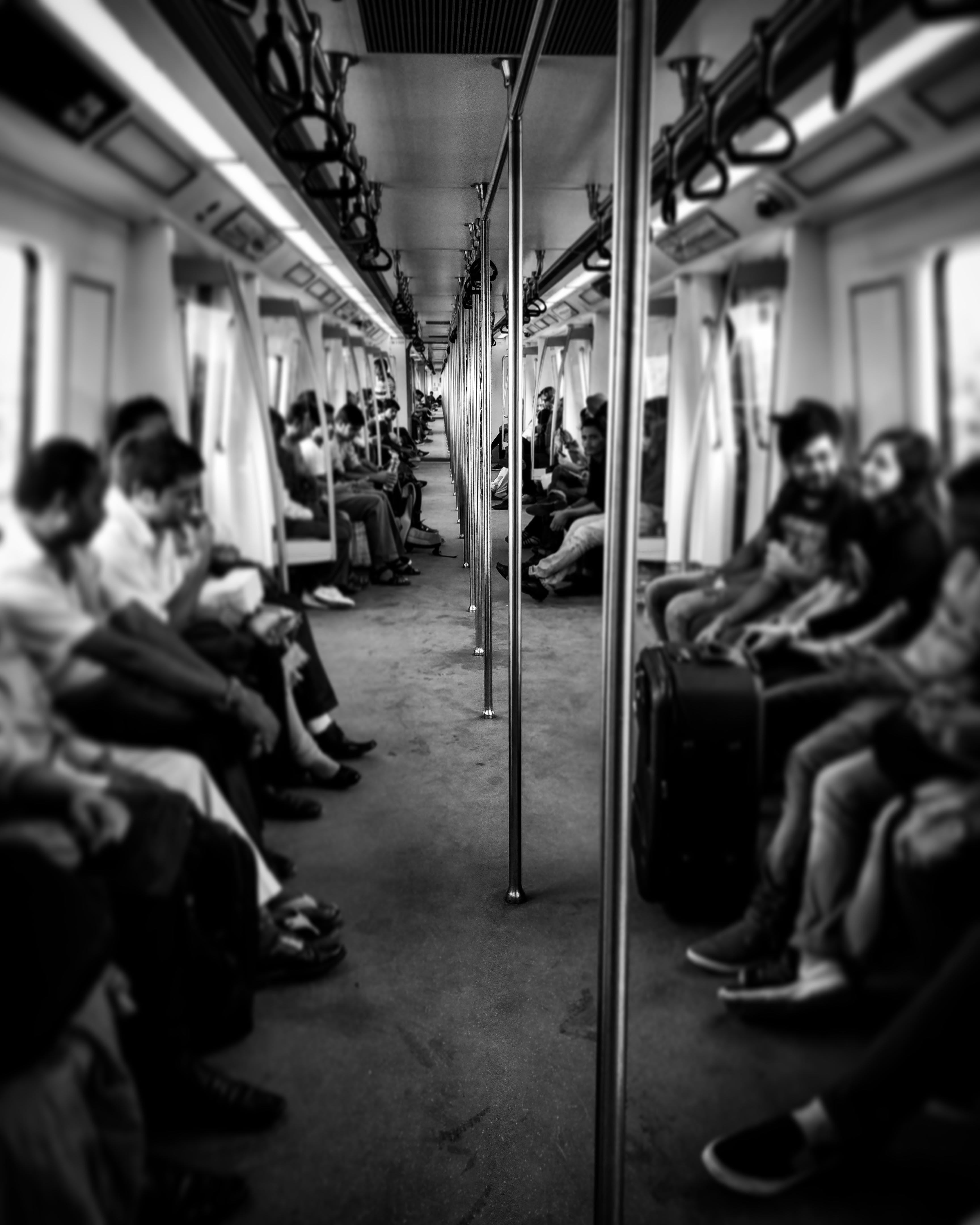 Grayscale Photography of Train Passengers