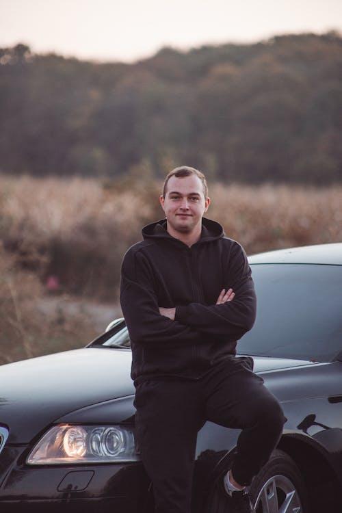 Man Leaning Against Car