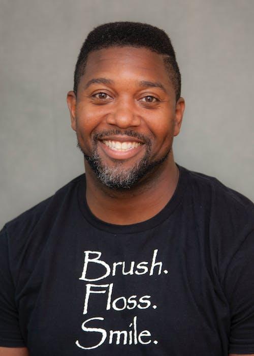 Man in Black Crew Neck Shirt Smiling