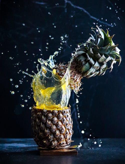 Pineapple Splash Against Black Background