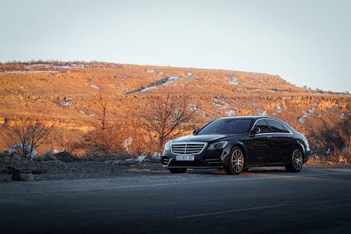 Black Audi a 4 on Road