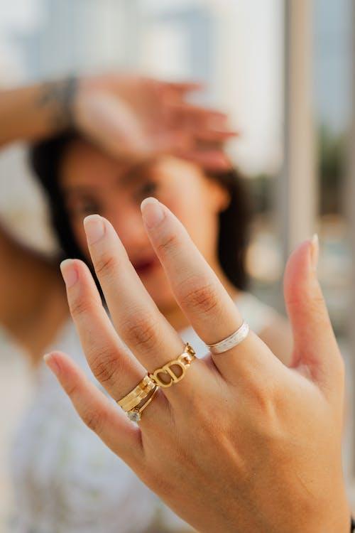 Woman Seen Through Hand