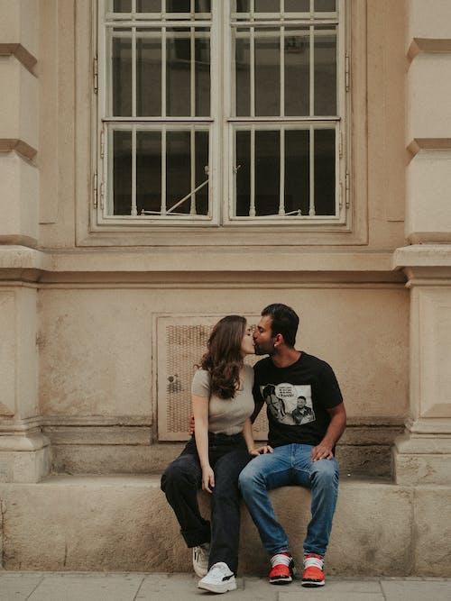 Couple Kissing Under Window