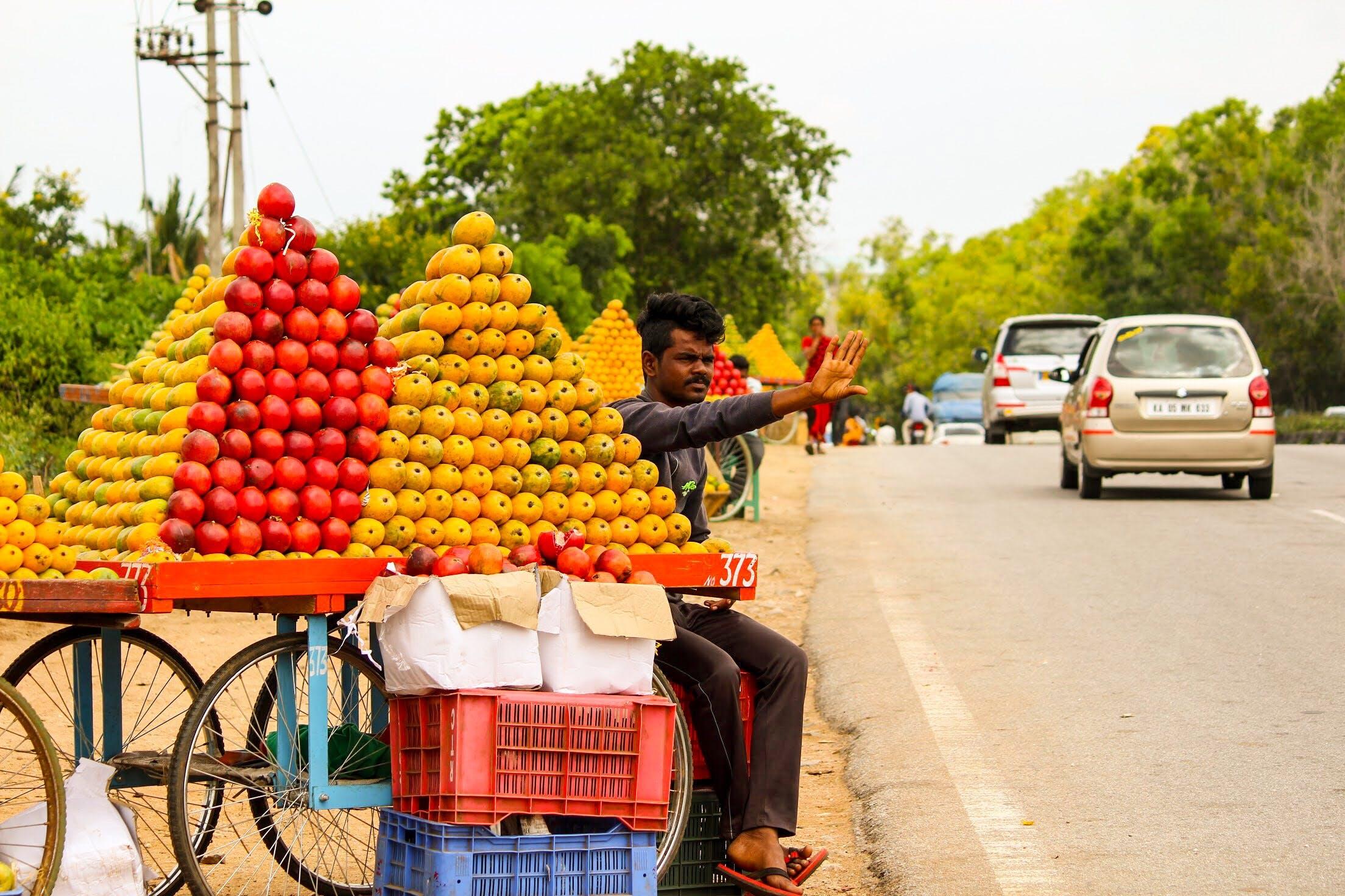 Free stock photo of fruits, mangoes, seller, street market