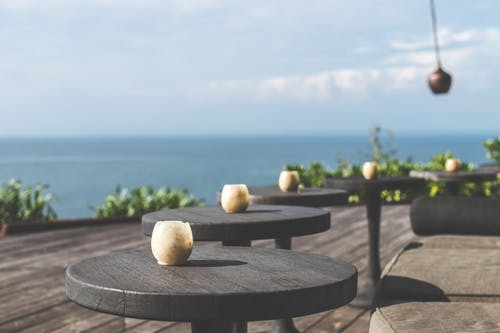 Tilt Lens Photography of Black Wooden Table