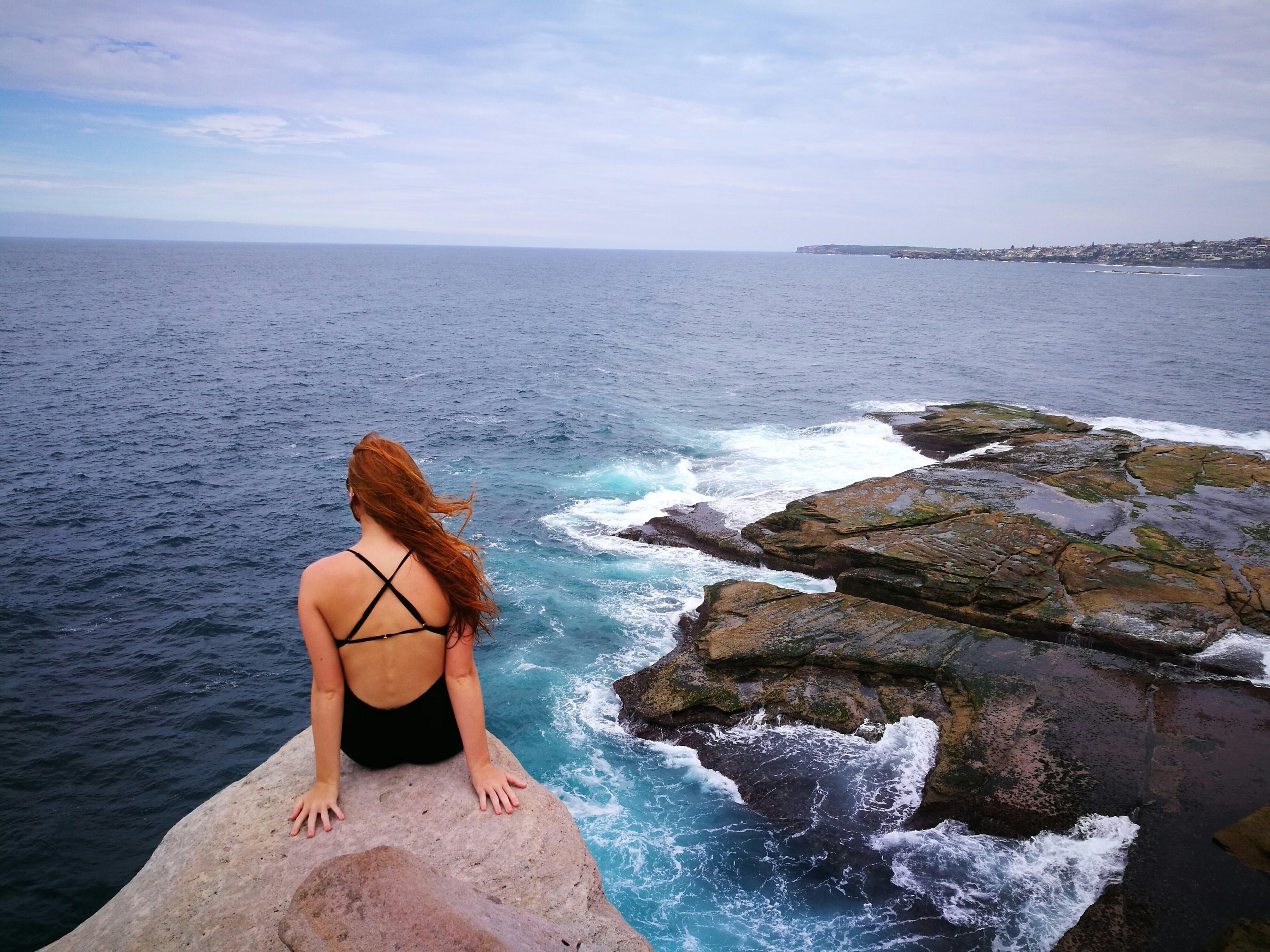 Woman Wearing Monokini on Rock Cliff Near Body of water