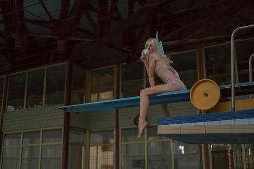 Woman Dressed as Fairy on Diving Board