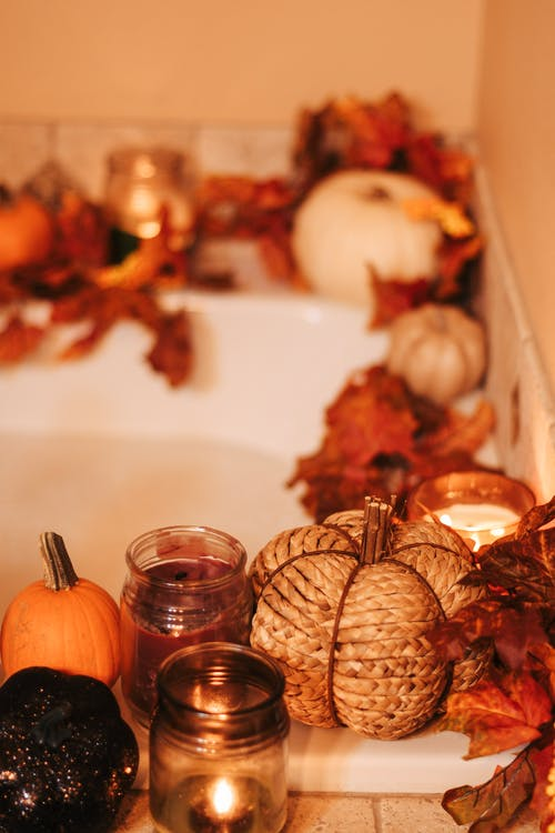Bathtub Decorated with Leaves and Candles