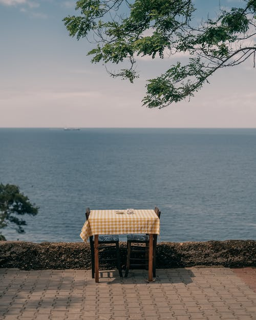 Tablecloth and the Table for 2 Nearby the Sea