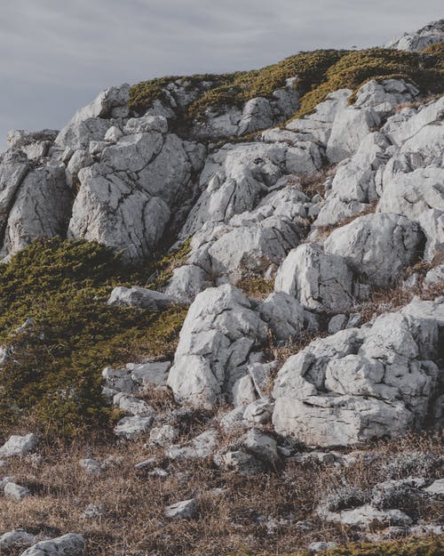 Gray Rock Formation on Green Grass Field