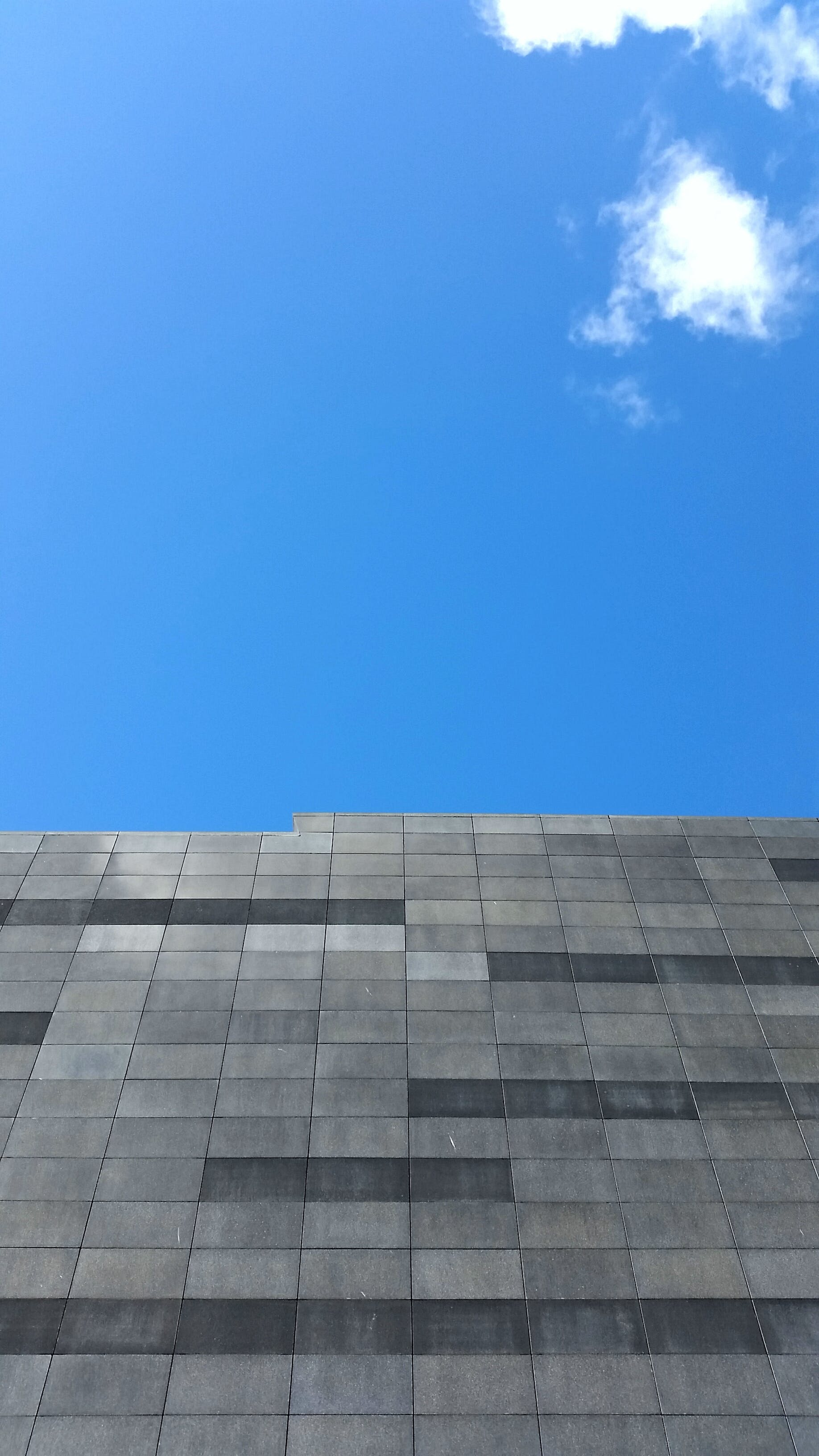 Free stock photo of blue sky, brick wall, clear sky, grey