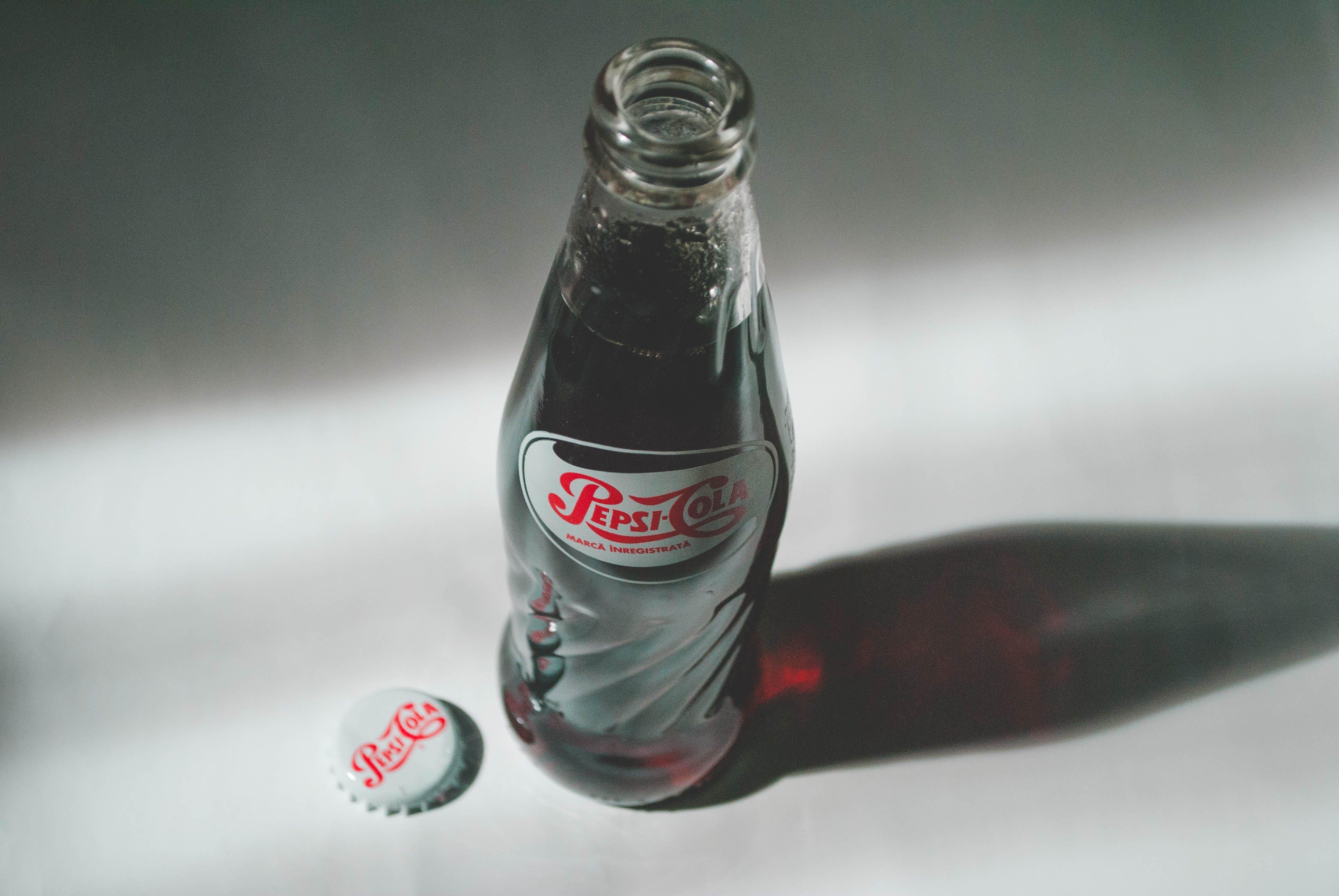 Pepsi-cola Soda Bottle on White Surface