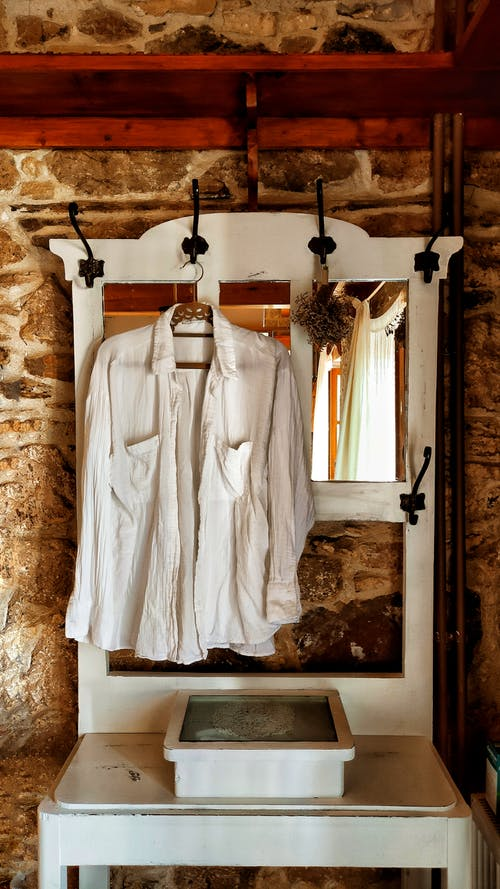 White Shirt Hanging on a Wall Hanger