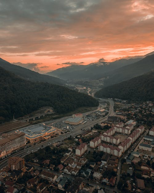 Sunset Over Blue Mountains and Apartment Buildings in Sochi