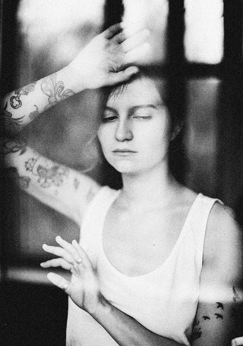 Black and White Portrait of Woman Seen Through Glass