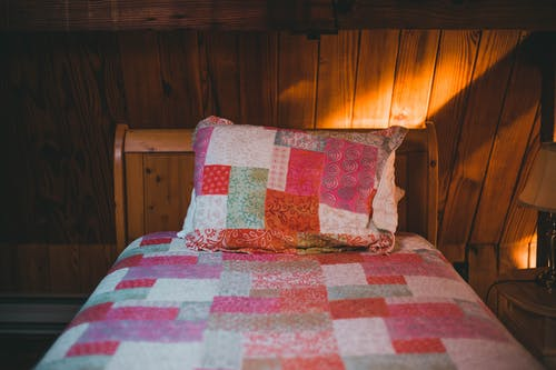 A Shot of a Bed in Wooden Interior
