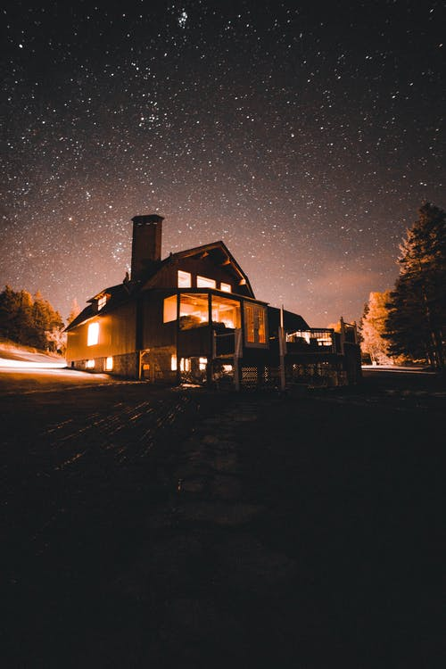 A Low Angle View of House Lighten up During Night Time