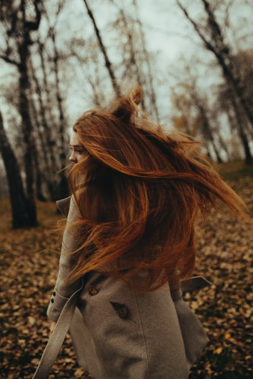 Photography of Brown-haired Woman Shaking Hair