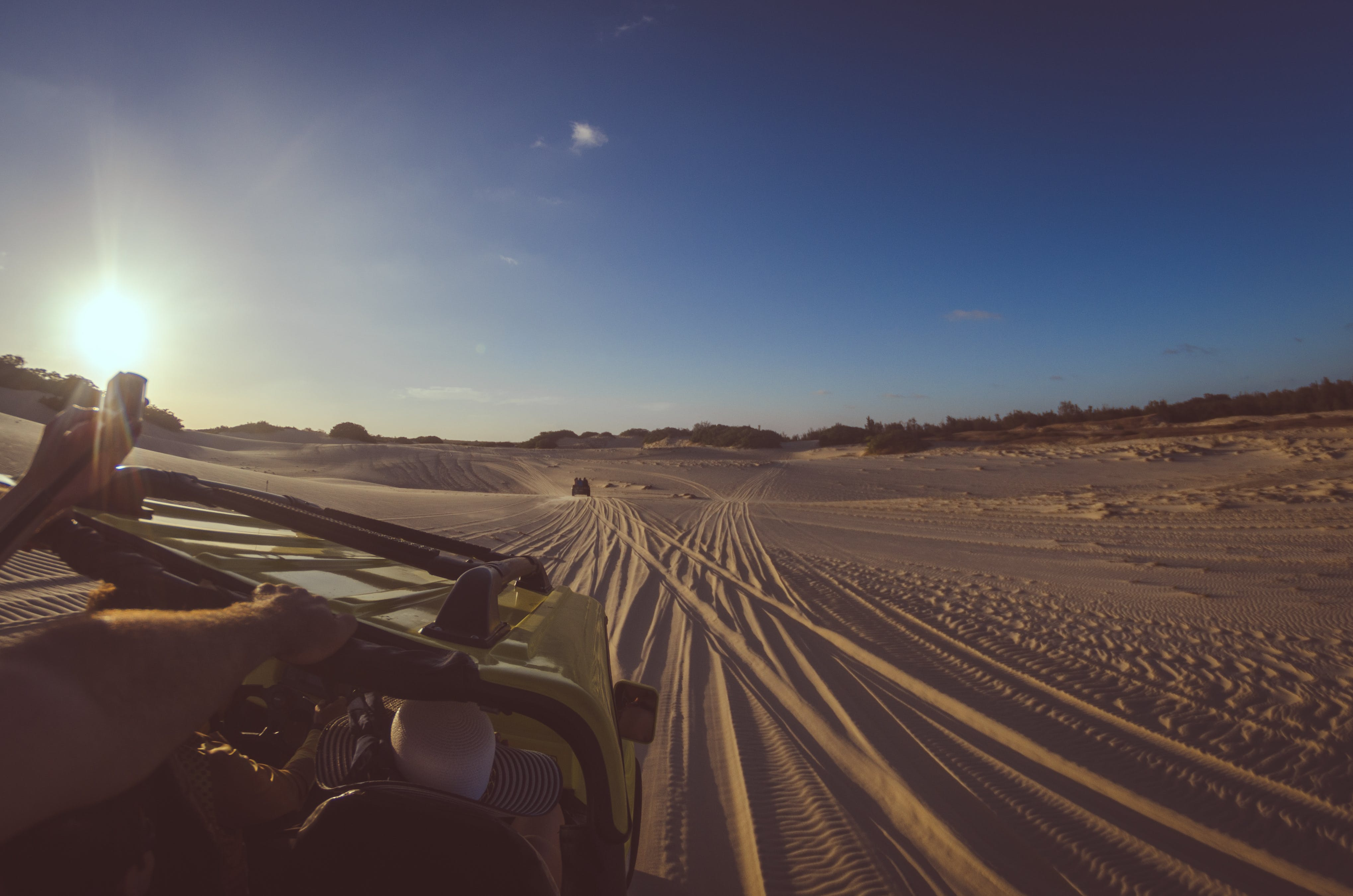 Person Riding Yellow Dune Buggy