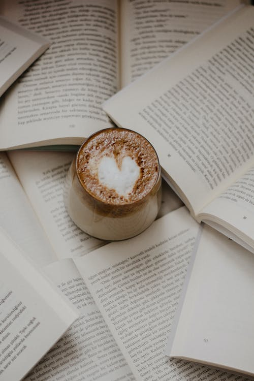 White Ceramic Cup on White Book Page