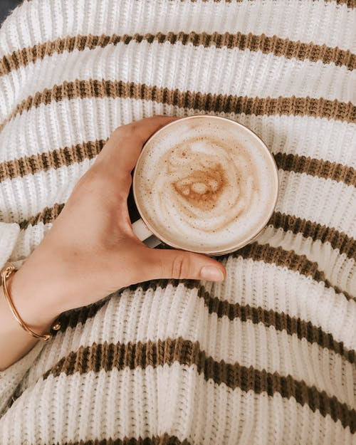 Person Holding White Ceramic Mug With Cappuccino