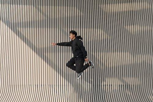 Man in Hoodie in Mid-Air