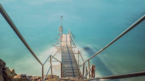 Brown Dock Bridge on Body of Water