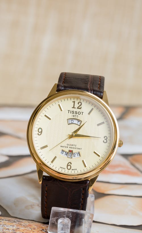 A Gold Watch with Leather Strap