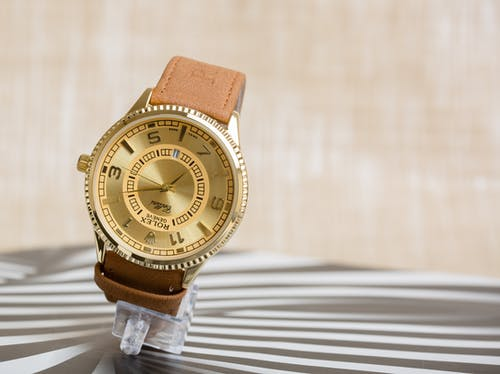 A Gold Rolex Watch with Leather Strap