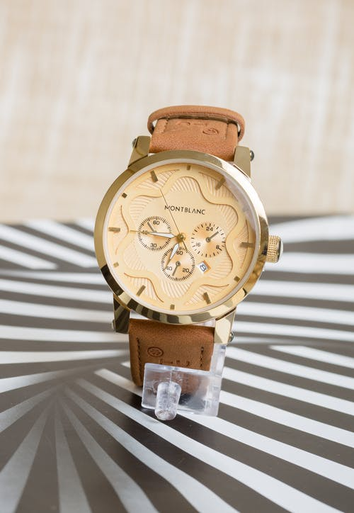 Gratis arkivbilde med armbåndsur, brun, gyllen