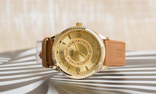 A Gold Rolex Analog Watch
