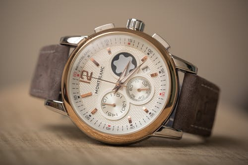 A Silver and Gold Chronograph Watch