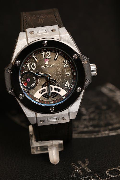 A Luxury Male Wristwatch on Black Background
