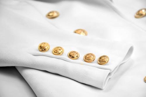 Foto profissional grátis de botões, botões de ouro, dentro de casa