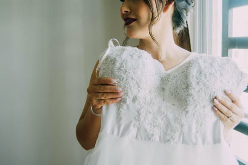 Woman in White Floral Lace Dress