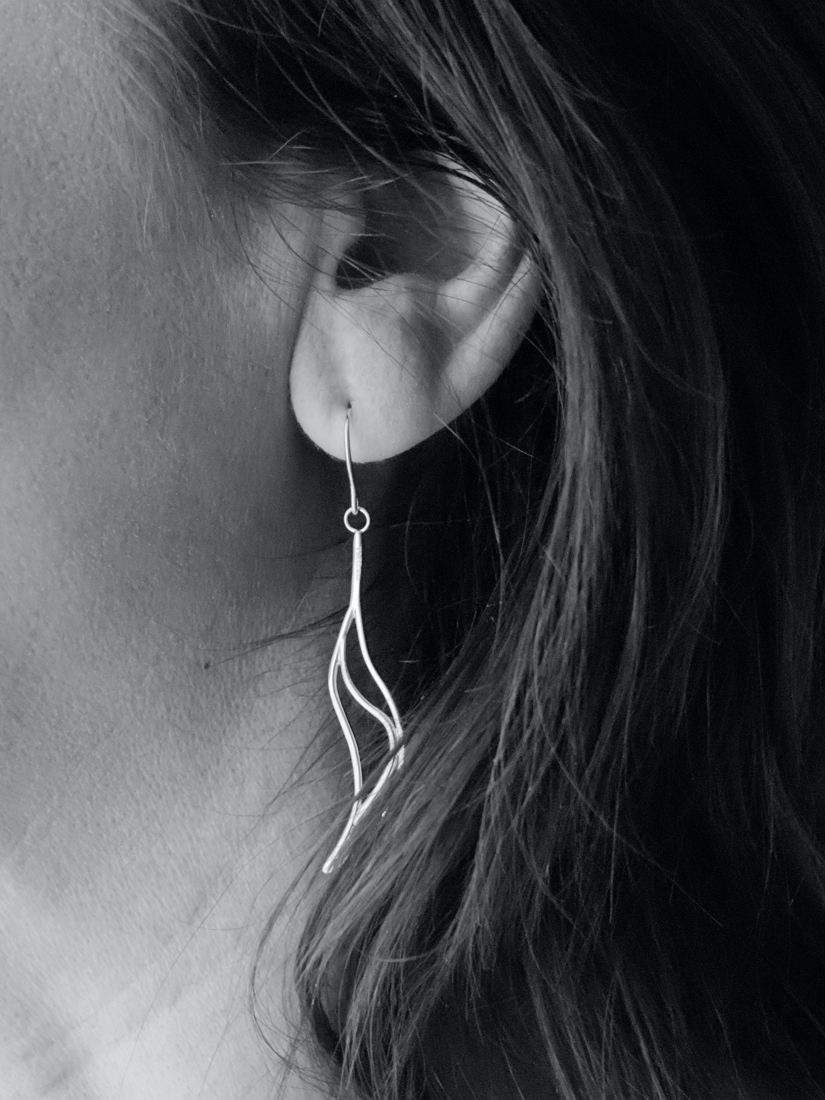 Grayscale Photo of Woman's Hook Earrings