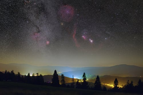 A Clear Night Sky Over a Valley